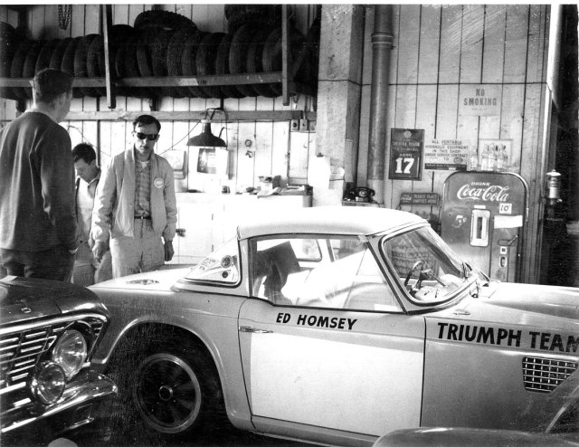 Triumph Ed at back of his and Gordon's TR-4 in garage in Vancouver